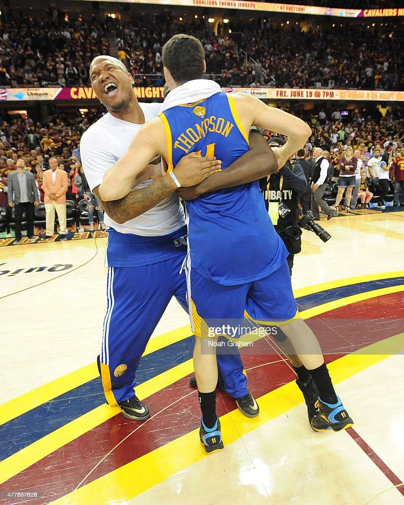 Marreese Speights and Klay Thompson of the Golden State Warriors celebrate winning the Larry O'Brein Trophy after Game Six of the 2015 NBA Finals...