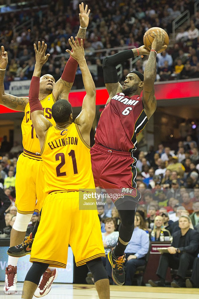 Marreese Speights #15 and Wayne Ellington #21 of the Cleveland Cavaliers put pressure on LeBron James #6 of the Miami Heat during the first half at Quicken Loans Arena on March 20, 2013 in Cleveland, Ohio.