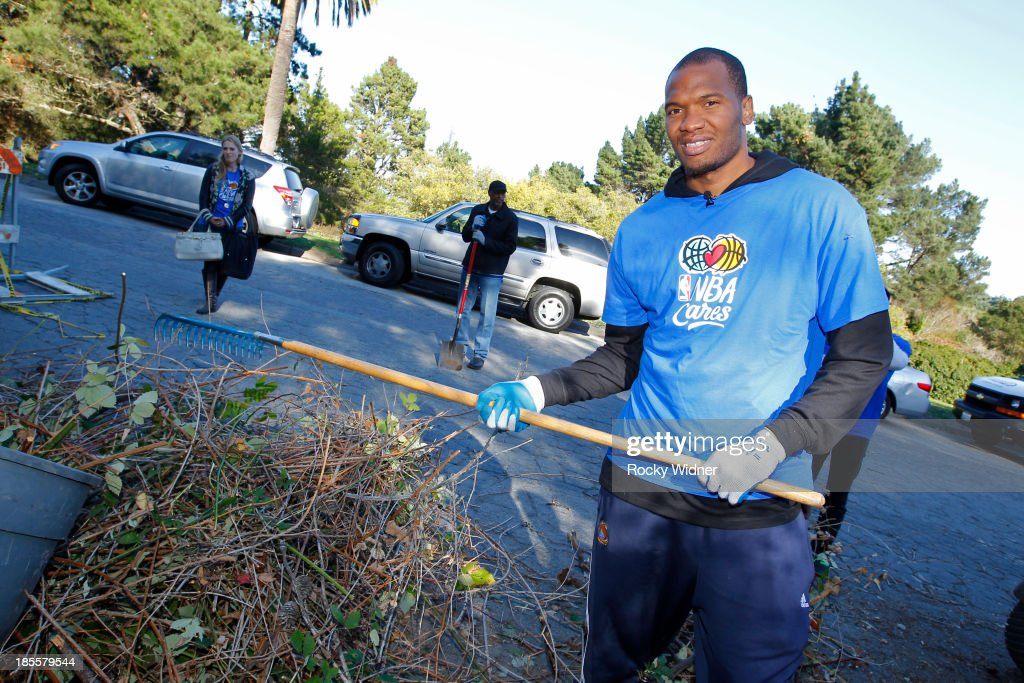 Marreese Speights helps to clean up McLaren park during Warriors Day Of Service as part of NBA Cares Week Of Service on October 21, 2013 in San Francisco, California.