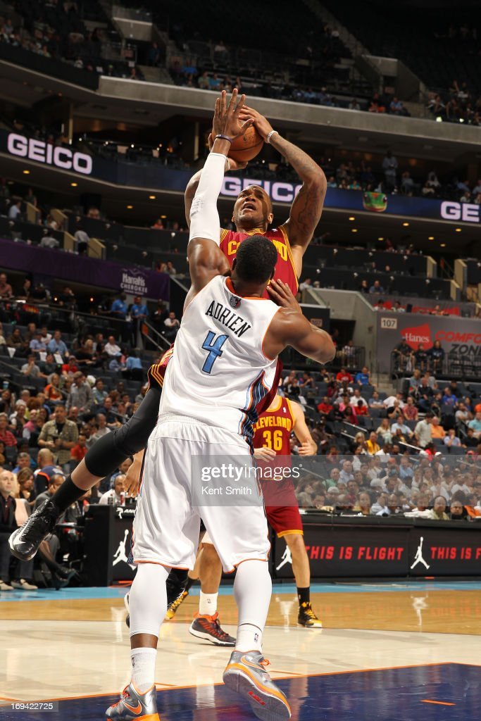 Marreese Speights #15 of the Cleveland Cavaliers drives to the basket against the Charlotte Bobcats at the Time Warner Cable Arena on April 17, 2013 in Charlotte, North Carolina.
