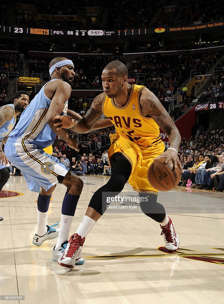 Marreese Speights #15 of the Cleveland Cavaliers drives to the hoop against Corey Brewer #13 of the Denver Nuggets at The Quicken Loans Arena on February 9, 2013 in Cleveland, Ohio.