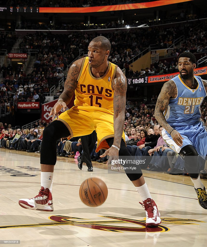 Marreese Speights #15 of the Cleveland Cavaliers drives to the hoop against Wilson Chandler #21 of the Denver Nuggets at The Quicken Loans Arena on February 9, 2013 in Cleveland, Ohio.