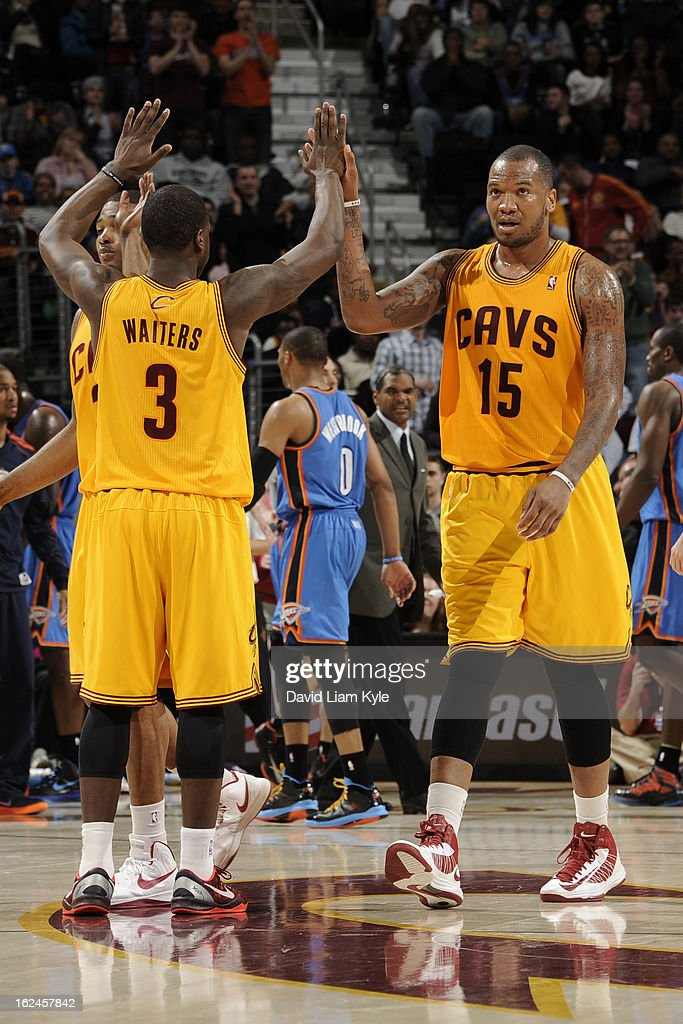 Marreese Speights #15 of the Cleveland Cavaliers gives his teammates a high five against the Oklahoma City Thunder at The Quicken Loans Arena on February 2, 2013in Cleveland, Ohio.