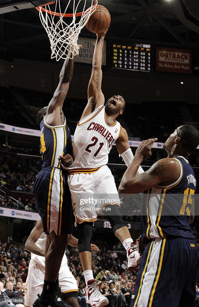 Marreese Speights #15 of the Cleveland Cavaliers goes up for the dunk against Paul Millsap #24 of the Utah Jazz at The Quicken Loans 11Arena on March 6, 2013 in Cleveland, Ohio.