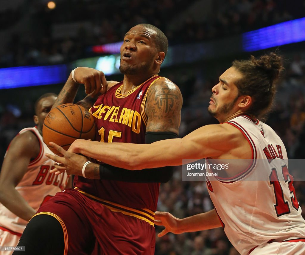 Marreese Speights of the Cleveland Cavaliers is fouled by Joakim Noah of the Chicago Bulls at the United Center on February 26 2013 in Chicago...