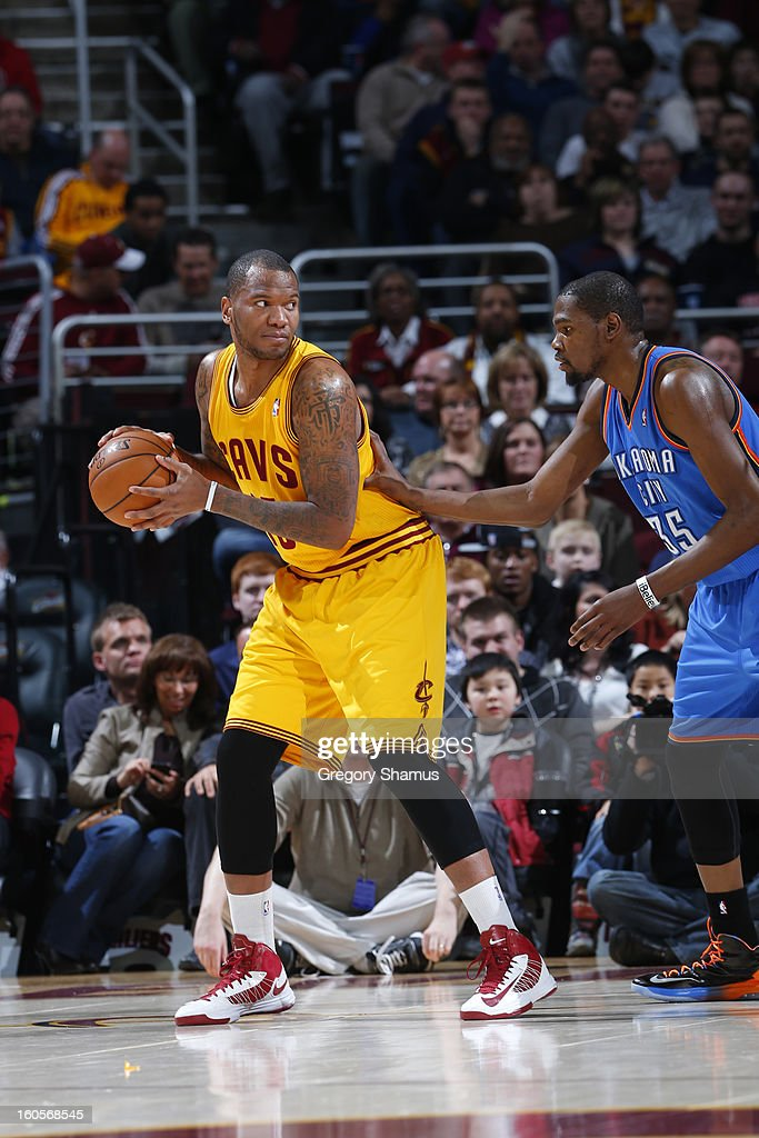 Marreese Speights #15 of the Cleveland Cavaliers posts up against Kevin Durant #35 of the Oklahoma City Thunder at The Quicken Loans Arena on February 2, 2013 in Cleveland, Ohio.