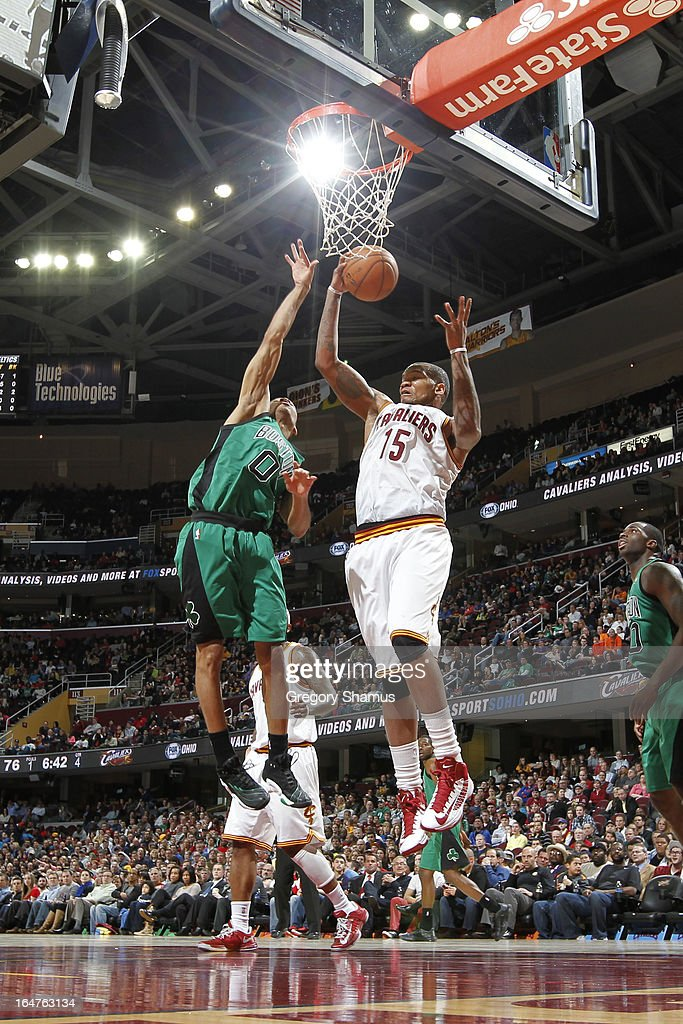 Marreese Speights #15 of the Cleveland Cavaliers rebounds against Avery Bradley #0 of the Boston Celtics at The Quicken Loans Arena on March 27, 2013 in Cleveland, Ohio.