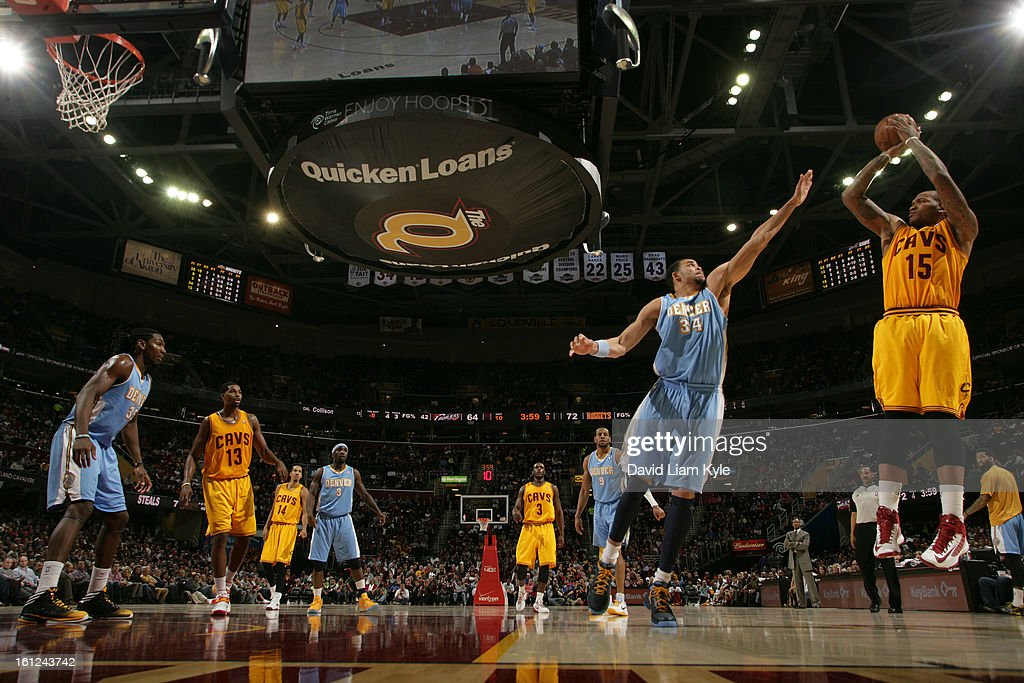 Marreese Speights #15 of the Cleveland Cavaliers shoots over JaVale McGee #34 of the Denver Nuggets at The Quicken Loans Arena on February 9, 2013 in Cleveland, Ohio.