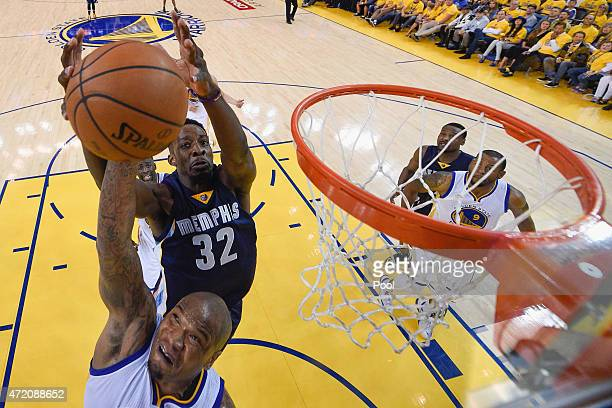 Marreese Speights of the Golden State Warriors and Jeff Green of the Memphis Grizzlies go for a rebound during Game One of the Western Conference...