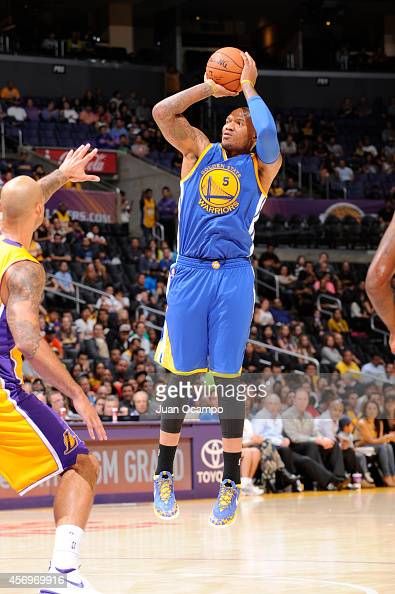 Marreese Speights of the Golden State Warriors attempts a shot during a game against the Los Angeles Lakers on October 9 2014 at the Staples Center...