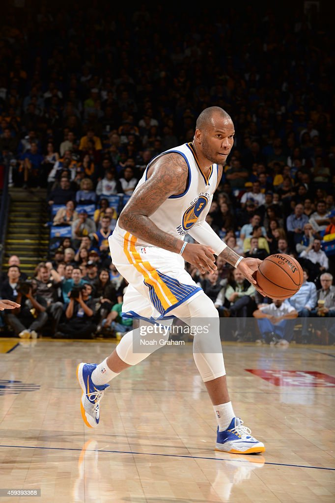 Marreese Speights of the Golden State Warriors brings the ball up court against the Utah Jazz on November 21 2014 at ORACLE Arena in Oakland...