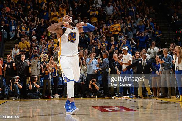 Marreese Speights of the Golden State Warriors celebrates a play during the game against the Utah Jazz on March 9 2016 at Oracle Arena in Oakland...