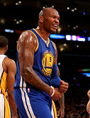Marreese Speights of the Golden State Warriors celebrates after making a basket and picking up a foul against the Los Angeles Lakers at Staples...