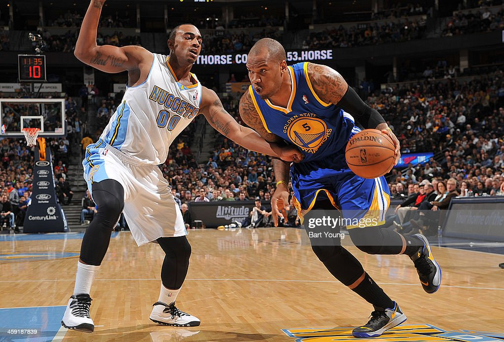 <a gi-track='captionPersonalityLinkClicked' href=/galleries/search?phrase=Marreese+Speights&family=editorial&specificpeople=4187263 ng-click='$event.stopPropagation()'>Marreese Speights</a> #5 of the Golden State Warriors drives to the basket against the Denver Nuggets on December 23, 2013 at the Pepsi Center in Denver, Colorado.