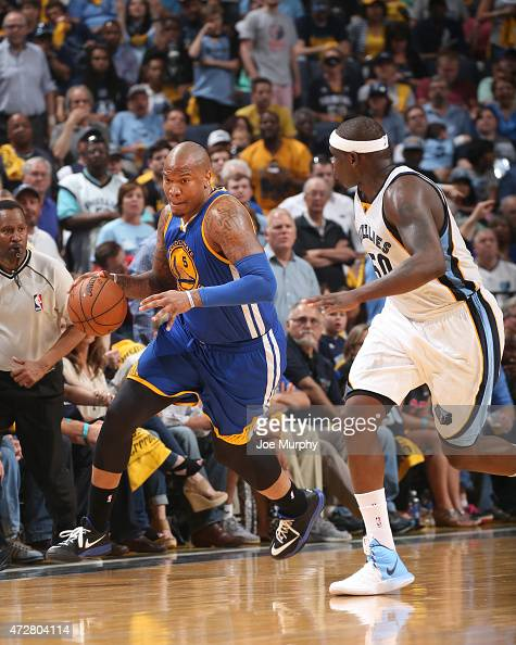 Marreese Speights of the Golden State Warriors drives to the basket against Zach Randolph of the Memphis Grizzlies during Game Three of the Western...