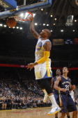 Marreese Speights of the Golden State Warriors dunks against the New Orleans Pelicans on December 17 2013 at Oracle Arena in Oakland California NOTE...
