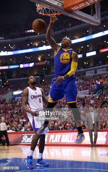 Marreese Speights of the Golden State Warriors dunks over DeAndre Jordan of the Los Angeles Clippers in Game One of the Western Conference...