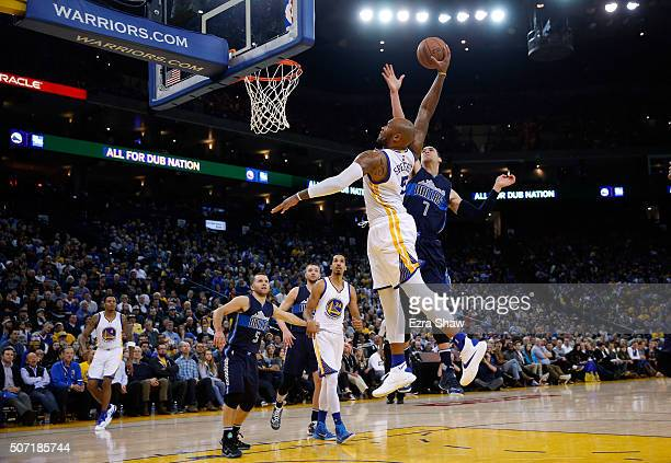 Marreese Speights of the Golden State Warriors dunks the ball on Dwight Powell of the Dallas Mavericks at ORACLE Arena on January 27 2016 in Oakland...