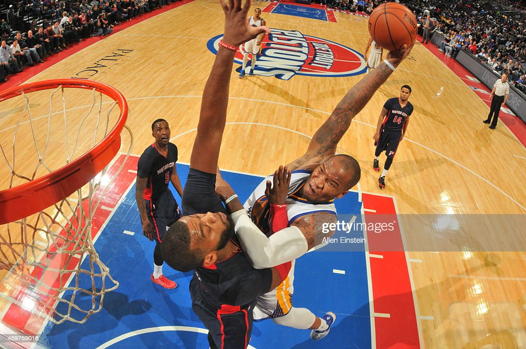 Marreese Speights of the Golden State Warriors goes up for a dunk against the Detroit Pistons during the game on November 30 2014 at The Palace of...