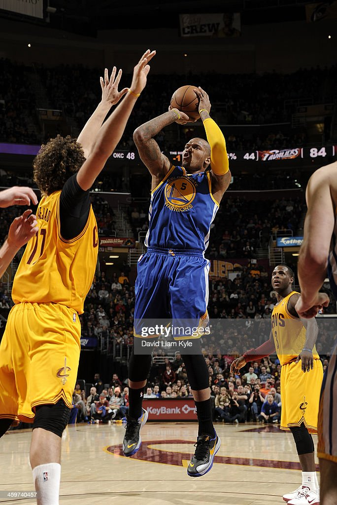 Marreese Speights of the Golden State Warriors goes up for the shot against Anderson Varejao of the Cleveland Cavaliers at The Quicken Loans Arena on...