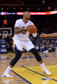 Marreese Speights of the Golden State Warriors looks to shoot the ball against the Portland Trail Blazers at ORACLE Arena on November 23 2013 in...