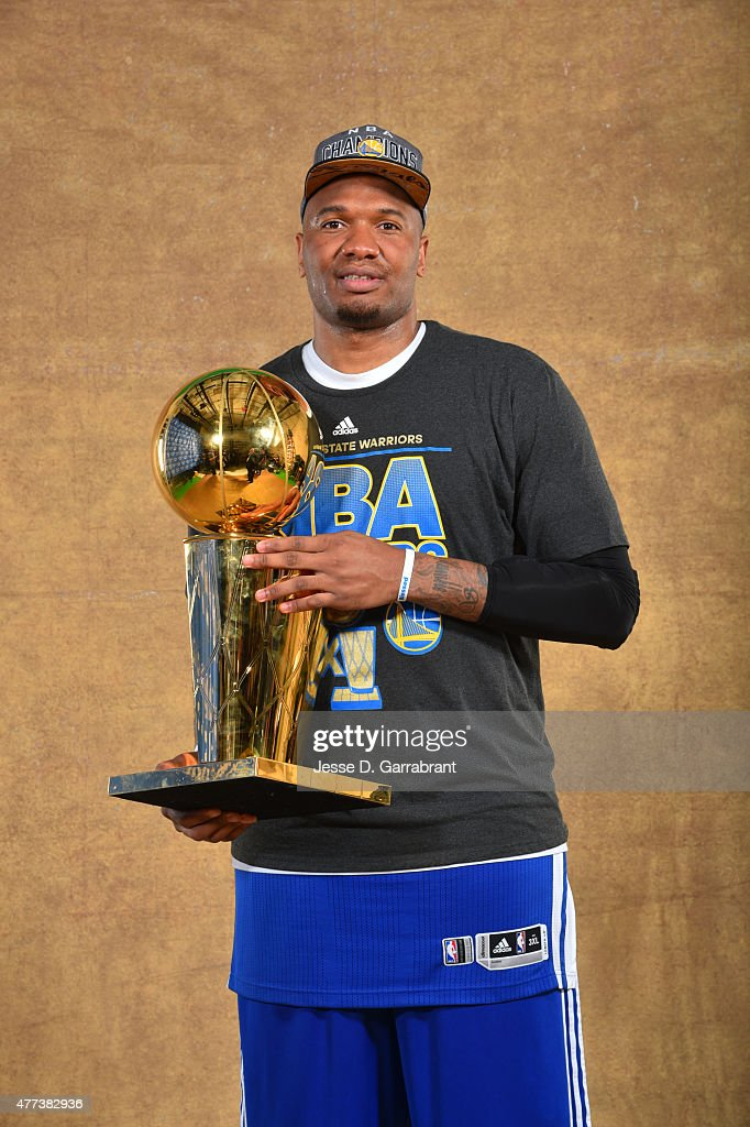 Marreese Speights of the Golden State Warriors poses for a portrait with the Larry O'Brien trophy after defeating the Cleveland Cavaliers in Game Six...