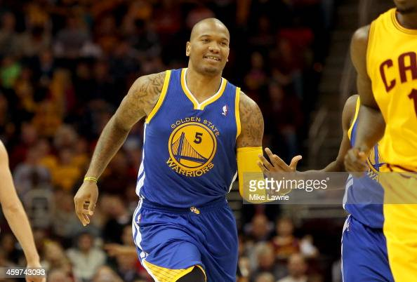 Marreese Speights of the Golden State Warriors reacts after a basket in the third quarter against the Cleveland Cavaliers at Quicken Loans Arena on...