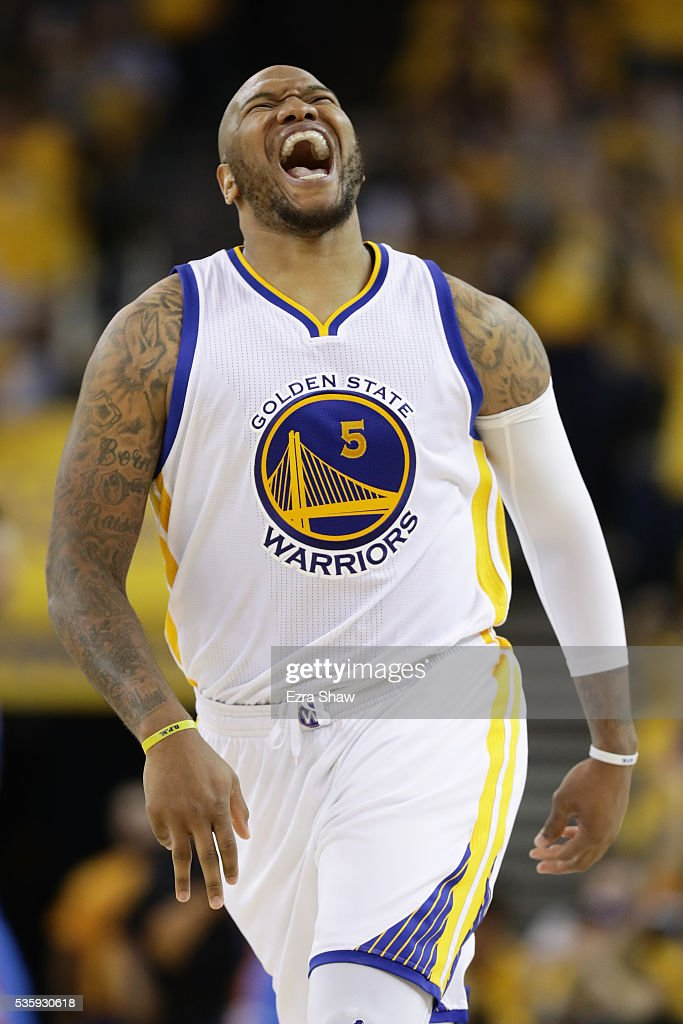 Marreese Speights of the Golden State Warriors reacts after making a threepoint basket against the Oklahoma City Thunder in Game Seven of the Western...
