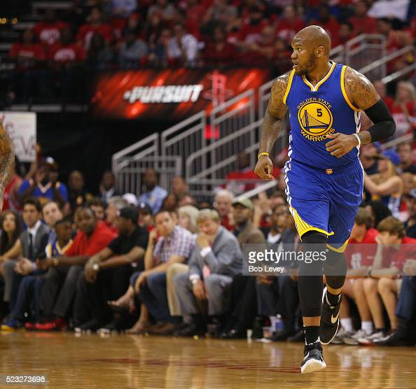 Marreese Speights of the Golden State Warriors runs down court after a made basket against the Houston Rockets at Toyota Center on April 21 2016 in...