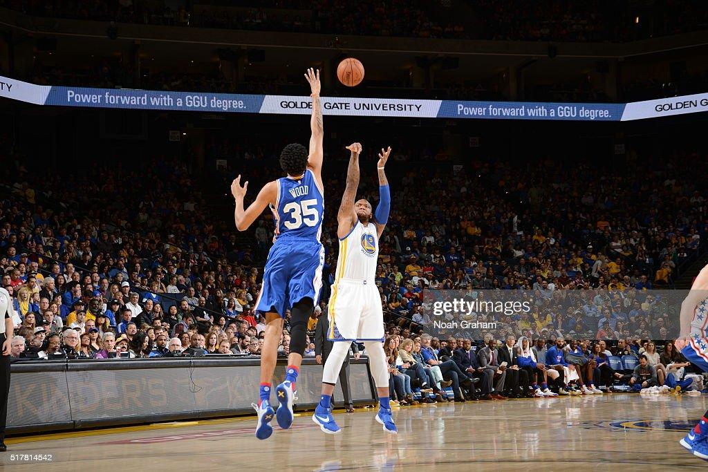 Marreese Speights of the Golden State Warriors shoots a three pointer against Christian Wood of the Philadelphia 76ers on March 27 2016 at Oracle...