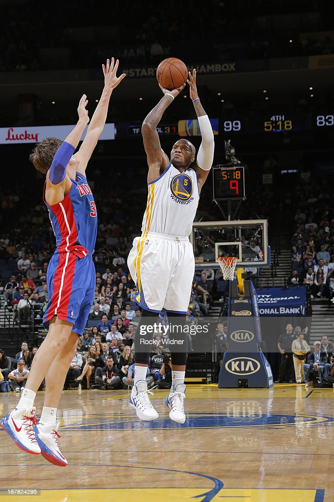 <a gi-track='captionPersonalityLinkClicked' href=/galleries/search?phrase=Marreese+Speights&family=editorial&specificpeople=4187263 ng-click='$event.stopPropagation()'>Marreese Speights</a> #5 of the Golden State Warriors shoots against <a gi-track='captionPersonalityLinkClicked' href=/galleries/search?phrase=Jonas+Jerebko&family=editorial&specificpeople=5942357 ng-click='$event.stopPropagation()'>Jonas Jerebko</a> #33 of the Detroit Pistons on November 12, 2013 at Oracle Arena in Oakland, California.