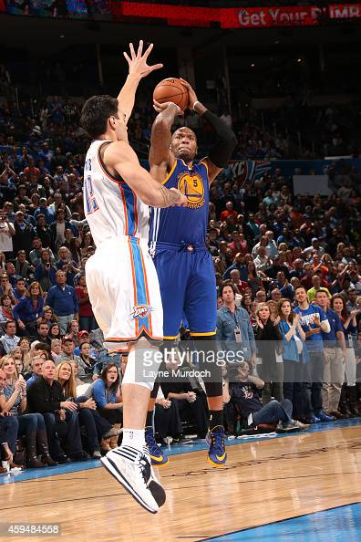 Marreese Speights of the Golden State Warriors shoots against the Oklahoma City Thunder on November 23 2014 at the Chesapeake Energy Arena in...