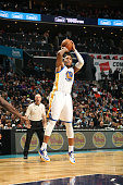 Marreese Speights of the Golden State Warriors shoots against the Charlotte Hornets during the game at the Time Warner Cable Arena on November 28...