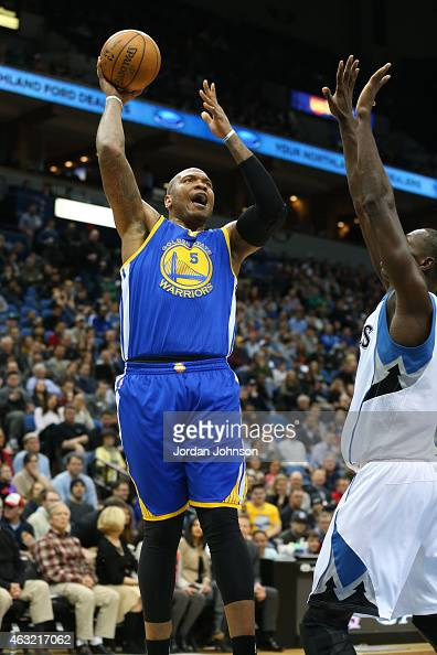 Marreese Speights of the Golden State Warriors shoots against the Minnesota Timberwolvesduring the game on February 11 2015 at Target Center in...