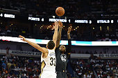 Marreese Speights of the Golden State Warriors shoots over Ryan Anderson of the New Orleans Pelicans during a game at the Smoothie King Center on...