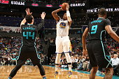 Marreese Speights of the Golden State Warriors shoots the ball against the Charlotte Hornets on December 2 2015 at Time Warner Cable Arena in...