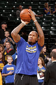 Marreese Speights of the Golden State Warriors warms up before the game against the Indiana Pacers on December 8 2015 at Bankers Life Fieldhouse in...