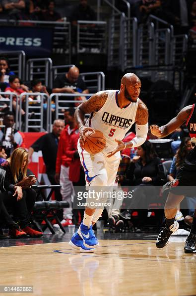 Marreese Speights of the Los Angeles Clippers drives to the basket against the Portland Trail Blazers during a preseason game on October 13 2016 at...