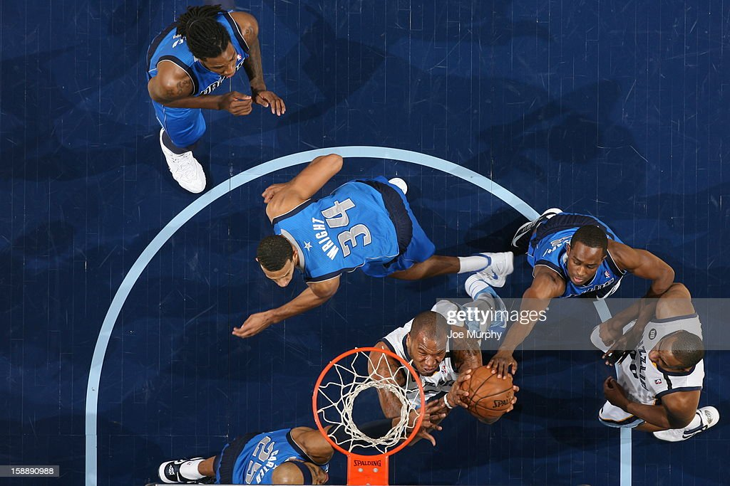 <a gi-track='captionPersonalityLinkClicked' href=/galleries/search?phrase=Marreese+Speights&family=editorial&specificpeople=4187263 ng-click='$event.stopPropagation()'>Marreese Speights</a> #5 of the Memphis Grizzlies goes to the basket against <a gi-track='captionPersonalityLinkClicked' href=/galleries/search?phrase=Brandan+Wright&family=editorial&specificpeople=3847557 ng-click='$event.stopPropagation()'>Brandan Wright</a> #34, <a gi-track='captionPersonalityLinkClicked' href=/galleries/search?phrase=Vince+Carter&family=editorial&specificpeople=201488 ng-click='$event.stopPropagation()'>Vince Carter</a> #25, and <a gi-track='captionPersonalityLinkClicked' href=/galleries/search?phrase=Rodrigue+Beaubois&family=editorial&specificpeople=5299423 ng-click='$event.stopPropagation()'>Rodrigue Beaubois</a> #3 of the Dallas Mavericks on December 21, 2012 at FedExForum in Memphis, Tennessee.