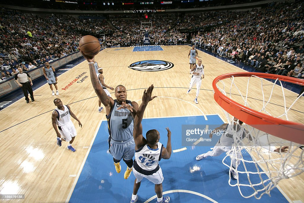 <a gi-track='captionPersonalityLinkClicked' href=/galleries/search?phrase=Marreese+Speights&family=editorial&specificpeople=4187263 ng-click='$event.stopPropagation()'>Marreese Speights</a> #5 of the Memphis Grizzlies puts up the hook shot against <a gi-track='captionPersonalityLinkClicked' href=/galleries/search?phrase=Elton+Brand&family=editorial&specificpeople=201501 ng-click='$event.stopPropagation()'>Elton Brand</a> #42 of the Dallas Mavericks on January 12, 2013 at the American Airlines Center in Dallas, Texas.