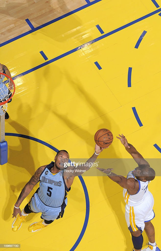 <a gi-track='captionPersonalityLinkClicked' href=/galleries/search?phrase=Marreese+Speights&family=editorial&specificpeople=4187263 ng-click='$event.stopPropagation()'>Marreese Speights</a> #5 of the Memphis Grizzlies rebounds against <a gi-track='captionPersonalityLinkClicked' href=/galleries/search?phrase=Carl+Landry&family=editorial&specificpeople=4111952 ng-click='$event.stopPropagation()'>Carl Landry</a> #7 of the Golden State Warriors on January 9, 2013 at Oracle Arena in Oakland, California.