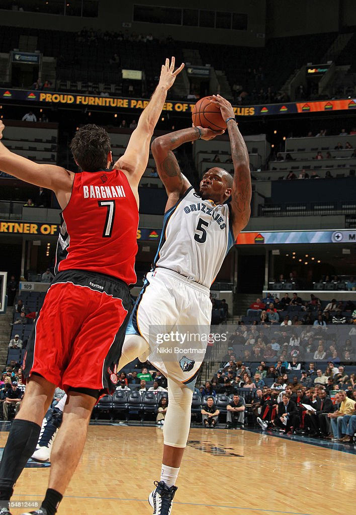 <a gi-track='captionPersonalityLinkClicked' href=/galleries/search?phrase=Marreese+Speights&family=editorial&specificpeople=4187263 ng-click='$event.stopPropagation()'>Marreese Speights</a> #5 of the Memphis Grizzlies shoots against <a gi-track='captionPersonalityLinkClicked' href=/galleries/search?phrase=Andrea+Bargnani&family=editorial&specificpeople=533014 ng-click='$event.stopPropagation()'>Andrea Bargnani</a> #7 of the Toronto Raptors on October 26, 2012 at FedExForum in Memphis, Tennessee.
