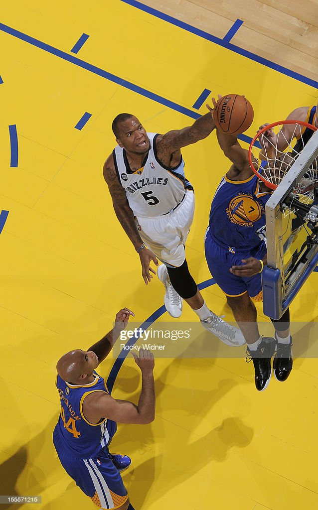 <a gi-track='captionPersonalityLinkClicked' href=/galleries/search?phrase=Marreese+Speights&family=editorial&specificpeople=4187263 ng-click='$event.stopPropagation()'>Marreese Speights</a> #5 of the Memphis Grizzlies shoots the ball against <a gi-track='captionPersonalityLinkClicked' href=/galleries/search?phrase=Carl+Landry&family=editorial&specificpeople=4111952 ng-click='$event.stopPropagation()'>Carl Landry</a> #7 of the Golden State Warriors on November 2, 2012 at Oracle Arena in Oakland, California.