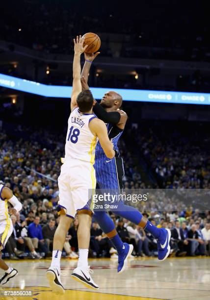 Marreese Speights of the Orlando Magic shoots over Omri Casspi of the Golden State Warriors at ORACLE Arena on November 13 2017 in Oakland California...
