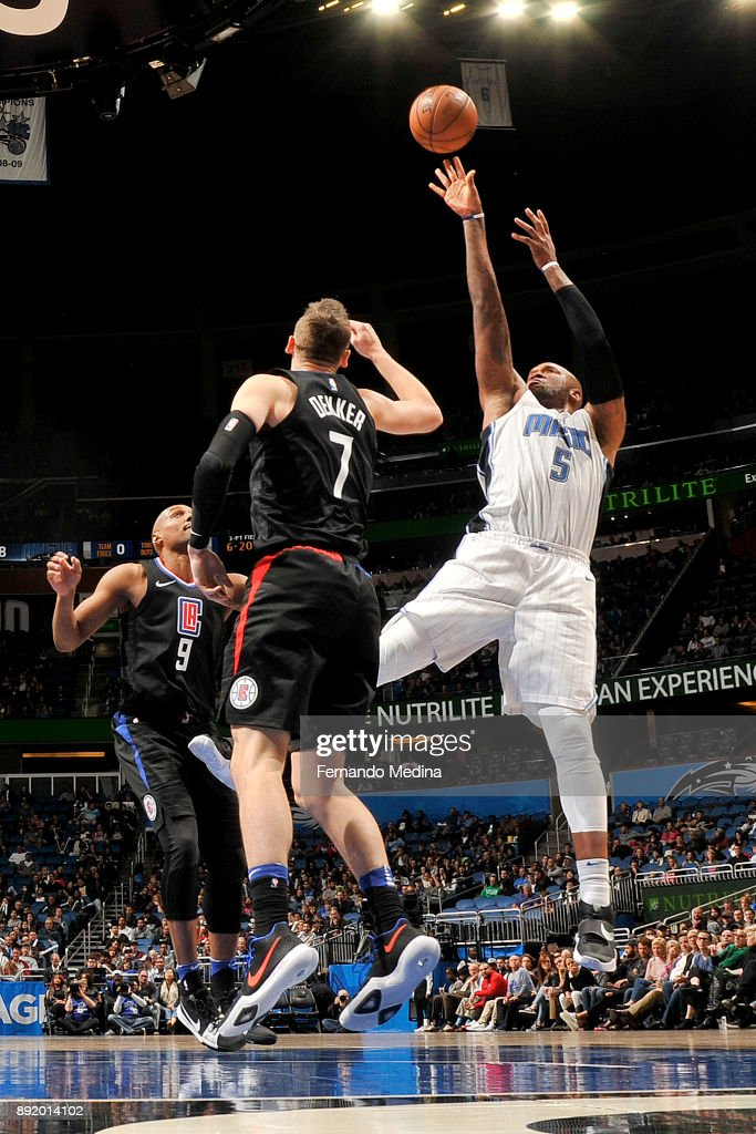 Marreese Speights #5 of the Orlando Magic shoots the ball against the LA Clippers on December 13, 2017 at Amway Center in Orlando, Florida.
