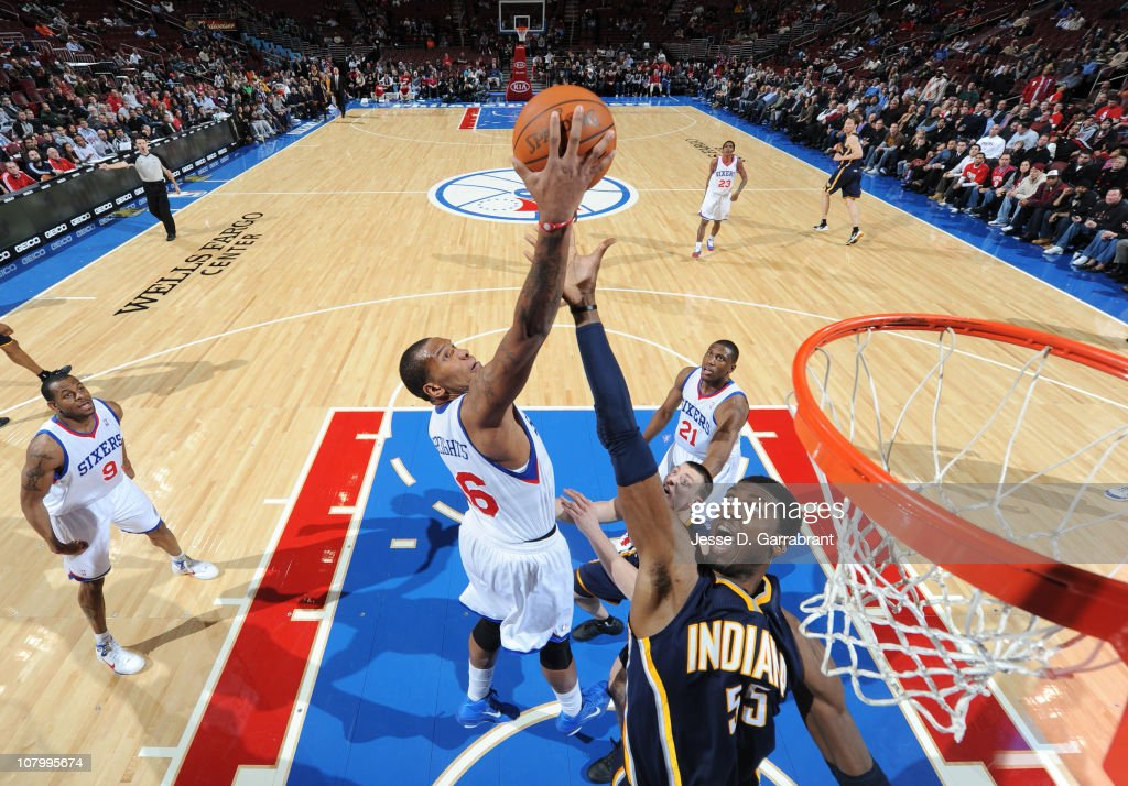 Marreese Speights of the Philadelphia 76ers grabs the rebound against Roy Hibbert of the Indiana Pacers during the game on January 11 2011 at the...