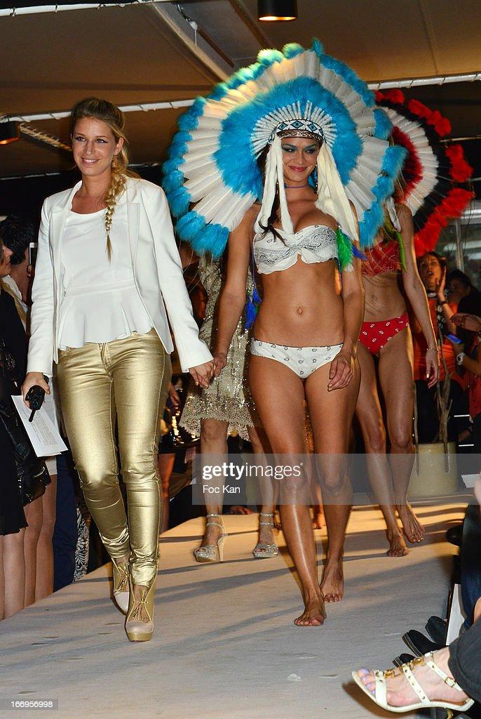 Marrezziani fashion designer Diane Maarek and a model walk the runway during 'Le Salon Sur L'Eau Marrezziani And Le Cap Swimming Suits' Show Cocktail At Quai Marcel Dassault on April 18, 2013 in Suresnes, France.