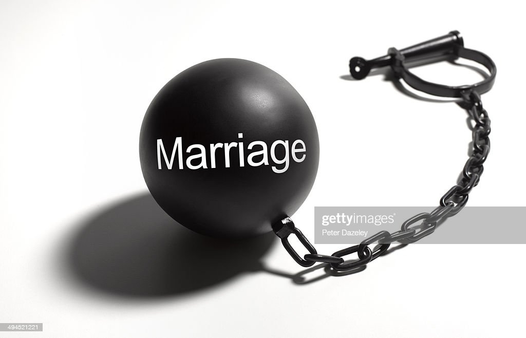 Marriage ball and chain : Stock Photo