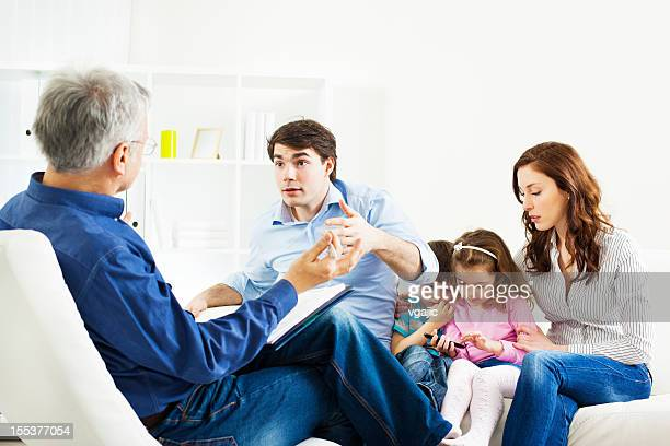 Marriage Therapy. Family Talking to Counselor