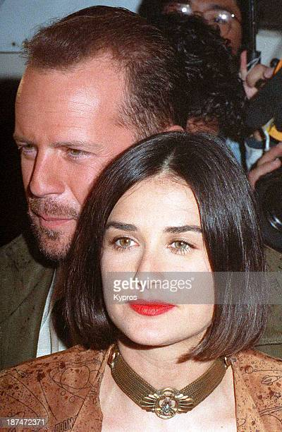 Married actors Bruce Willis and Demi Moore at Planet Hollywood circa 1992